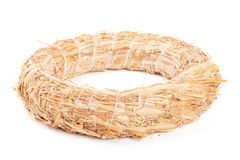 Wreath made with straw. On white background Royalty Free Stock Image