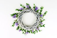 Wreath made of wicker circle, the branches of eucalyptus and purple flowers. Flowers background. Wreath made of wicker circle, the branches of eucalyptus and stock photography