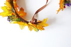 Autumn wreath of autumn leaves. Do it yourself on the instructions. A wreath of maple leaves for the autumn holidays. Crown made independently by the instruction royalty free stock photo