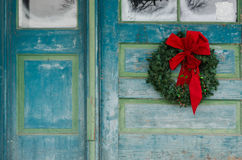 Wreath and old door Royalty Free Stock Image