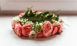 Wreath of pink and white roses. On the windowsill Royalty Free Stock Photo