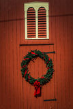 Wreath on red barn siding Stock Image