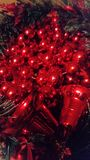 A wreath of red festive balloons and bells stock photo