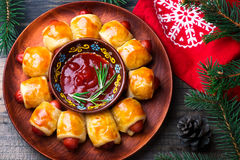 Wreath from sausage rolls in a Christmas decor. Royalty Free Stock Photos