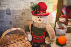 Wreath with snowman sitting on it with text Merry Christmas Stock Photo