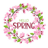 Wreath from spring flowers. Blossoming branches of apple-tree or cherry in form of round frame for the text. Royalty Free Stock Photography