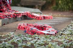 Wreath at a War memorial in the UK. Poppy wreaths at a World War I and II memorial in the UK royalty free stock photo