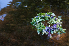 Wreath on water. Slavic divination, tradition. Outdoor Royalty Free Stock Photo
