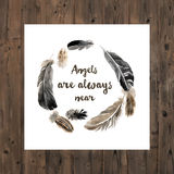 Wreath with watercolor feathers and type design Stock Images