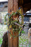 Wreath of wildflowers. On a nail on the pole Royalty Free Stock Photos