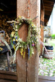 Wreath of wildflowers. On a nail on the pole Stock Photos