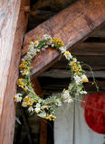 Wreath of wildflowers. On a nail on the pole Stock Photo