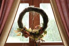 Wreath in window Stock Photo