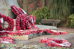 Wreath at a World War I and II memorial. Poppy wreaths at a World War II memorial in the UK stock images