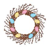 A wreath of young willow branches, decorated with colorful Easter eggs. vector illustration