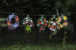 Wreaths. Flower wreaths for sale near cemetery fence Royalty Free Stock Photography