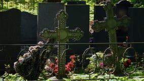 Wreaths on iron grave crosses stock footage