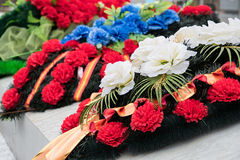 Wreaths in memory of those killed in 1941-1945. Monument on the road of life. Close-up Stock Photos