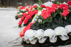 Wreaths in memory of those killed in 1941-1945. Monument on the road of life. Close-up Royalty Free Stock Photos