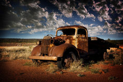 Wreck. An old Ute lay abandoned in the heart of a baron landscape Royalty Free Stock Image