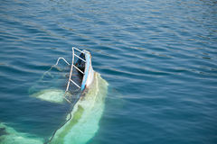 Wreck. Of a boat sticking out from the water surface stock photo