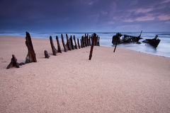 Wreck on australian beach at dawn Royalty Free Stock Photography