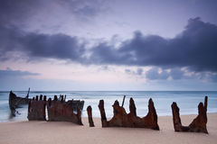 Wreck on australian beach at dawn Stock Photo