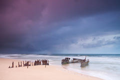Wreck on australian beach at dawn Stock Image