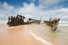 Wreck on australian beach during the day Stock Images
