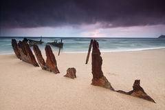 Wreck on australian beach at sunrise Stock Image