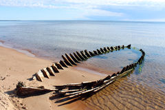 Wreck at the beach. Old wreck at the Baltic sea beach royalty free stock photo