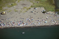 Wreck Beach with sunbathers in Vancouver Stock Image