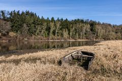 Wreck of a boat on the shores of the lake Royalty Free Stock Photo