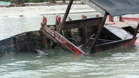 Wreck boat in water. Wooden boat wreck in water stock video footage