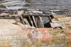 The wreck. Boats both good and bad, seaworthy and wrecked on the slipway at Saltash, Cornwall UK Stock Photos