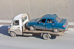 Wreck car carrier truck deliver damaged car Royalty Free Stock Photos