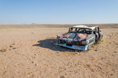 Wreck of classic saloon car abandoned deep in the Namib Desert of Angola. What caused the accident and what happened to the travelers remains a mystery Stock Photography