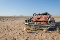 Wreck of classic saloon car abandoned deep in the Namib Desert of Angola. What caused the accident and what happened to the travelers remains a mystery Stock Images