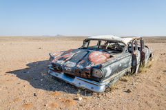Wreck of classic saloon car abandoned deep in the Namib Desert of Angola. What caused the accident and what happened to the travelers remains a mystery Royalty Free Stock Images