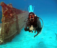 Wreck and diver. Diver exploring the wreck of the Nicholson, Sunset House, Grand Cayman Stock Photo