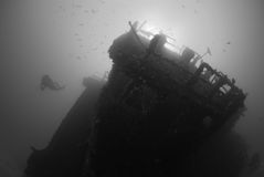 Wreck Diving. A diver explores a shipwreck off the coast of Fort Lauderdale, FL royalty free stock photography