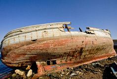 Wreck of a fishing boat. Old fishing boat wreck lying on a beach Stock Photo