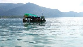 Wreck of fishing boat at Koh Chang Island. The wreck of a fishing boat at Koh Chang Island near Bang Bao village in Thailand Stock Images