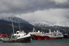 Wreck in the Harbor of Ushuaia. The Harbor of Ushuaia on the Beagle Channel. The channel was named after the ship HMS Beagle on which travelled Charles Darwin Royalty Free Stock Photo