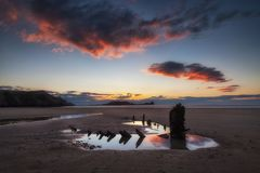 The wreck of the Helvetia and Worms Head Stock Photos
