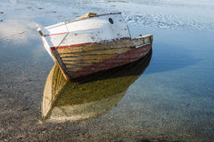The wreck of an old fishing boat on the sea shore. Lofoten archipelago. The wreck of an old fishing boat on the sea shore. Lofoten archipelago, Norway Royalty Free Stock Image