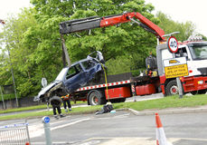Wreck recovery. Recovery team removes a wrecked car from the scene of a traffic accident royalty free stock images