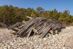Wreck of the`Swiks`. The wreck of the schooner `Swiks` as it lays on the beach of Swedens island of Öland stock photography