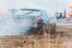 Wreck scrap cars dirt race. Selective focus on splashing mud Stock Photo