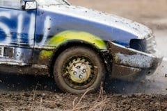 Wreck scrap cars dirt race. Selective focus on splashing mud Royalty Free Stock Photos